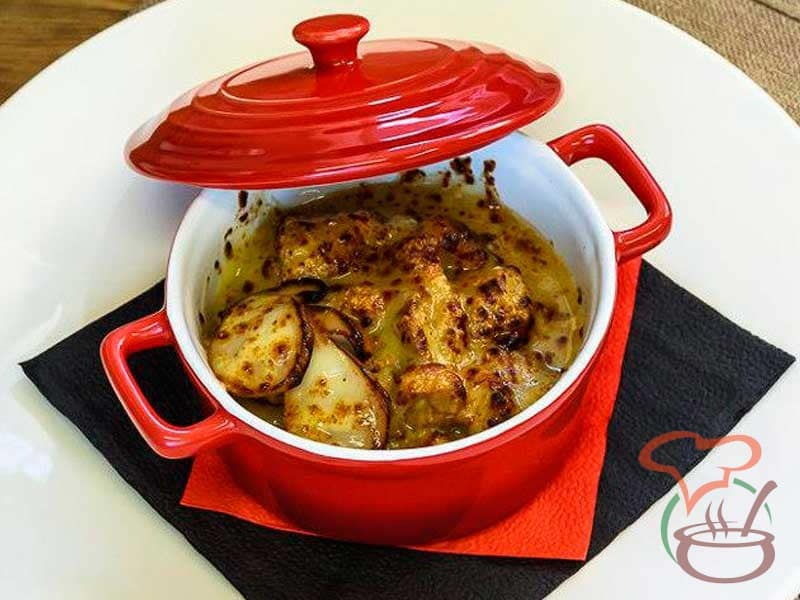 Rabbit baked in a casserole with wild mushrooms