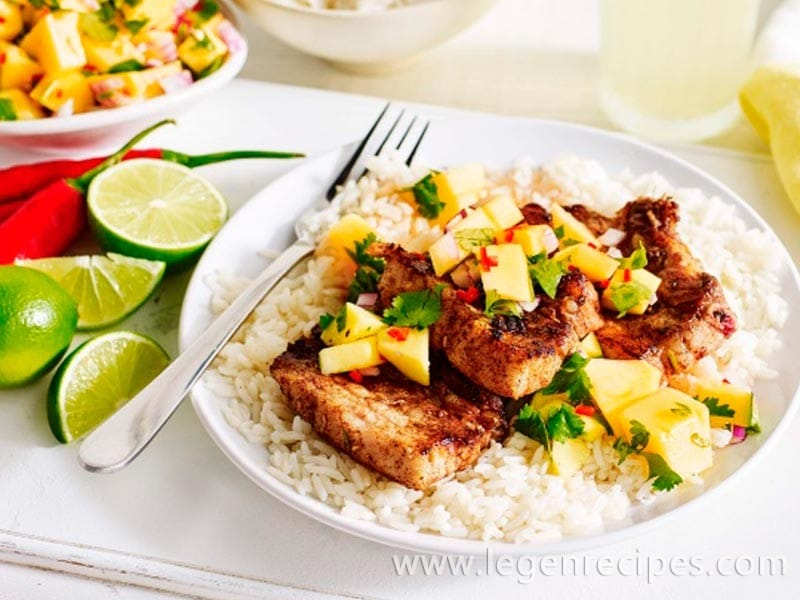 Barbecued Jamaican pork ribs with mango salsa