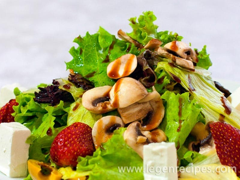 Champignon salad with fruit and cheese
