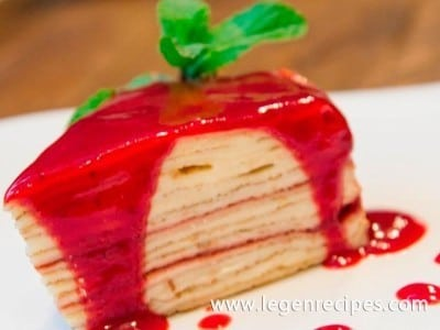Pancake cake with berry sauce