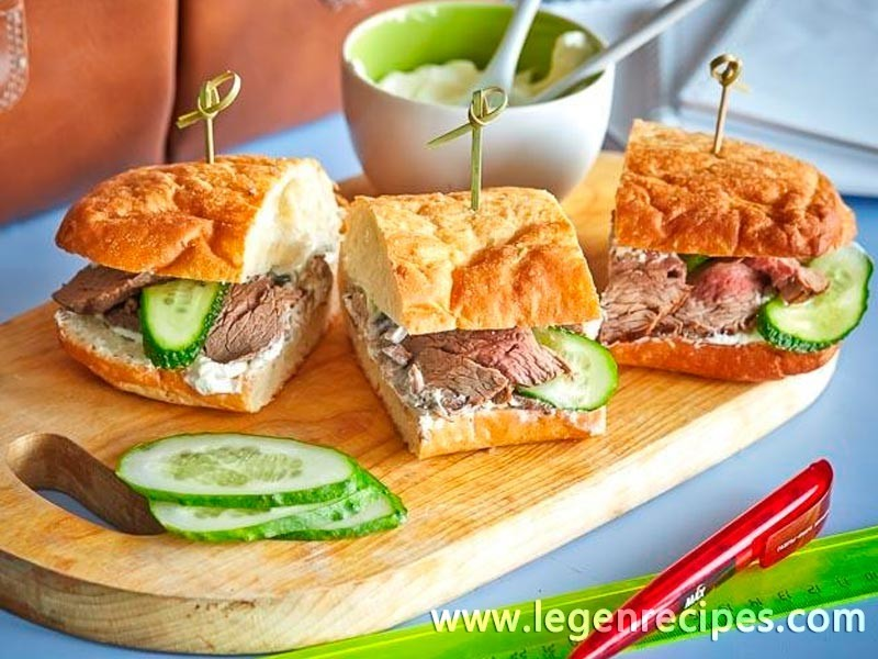 Sandwich with roast beef and cucumbers