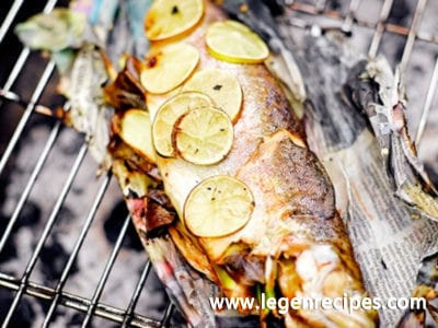 Barbecued trout in newspaper